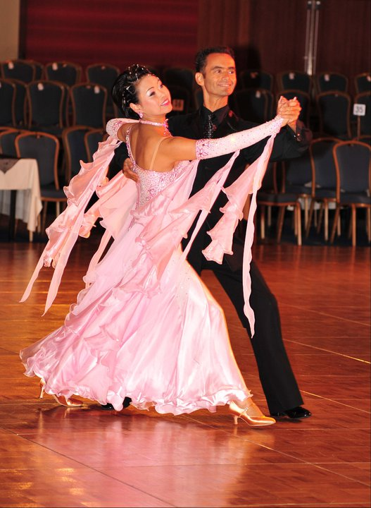 The multi-faceted Huang, pictured here at the 2011 Twin Cities Open with Jay Larson, is also a competitive ballroom dancer.